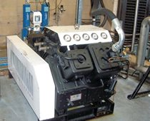 Water cooled gas recovery compressor